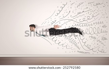 Business man flying with hand drawn lines comming out concept - stock photo