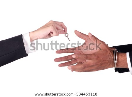 business man from handcuffs.which woman holds the key On a white background