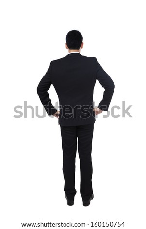 Business man from the back - looking at something - stock photo