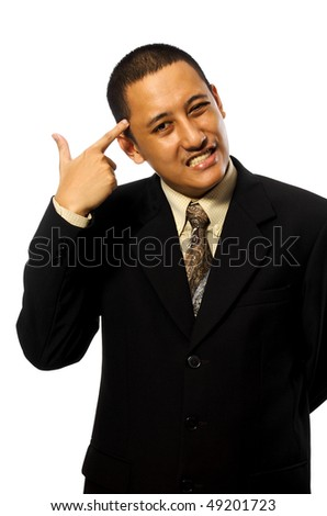 Business Man Give a Hand sign shooting himself. Isolated on white background - stock photo