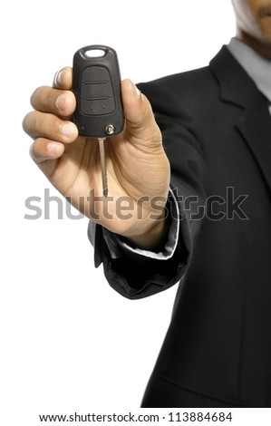 Business man give car key isolated over white background - stock photo