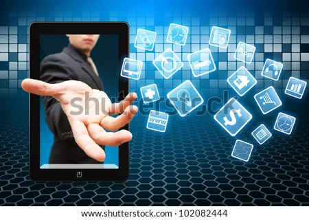 Business man give the Application icons from touch pad - stock photo