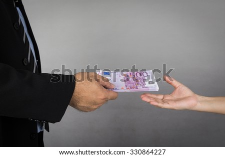 business man  gives money to human