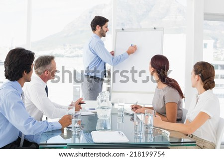 Business man giving a presentation to his team - stock photo