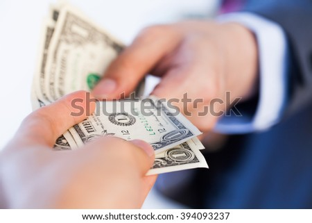 Business man giving bank notes to another person. Corruption and Payment concept