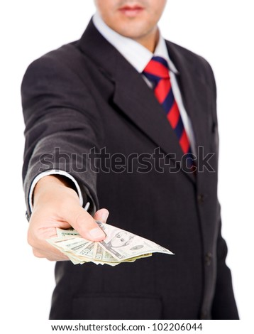 Business man giving dollar bills, isolated on white - stock photo
