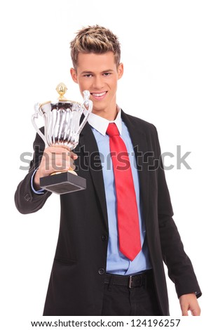 Business man giving you a trophy cup with pride
