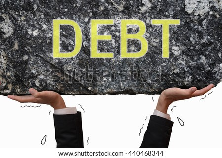 Business man hand carrying and making effort to push up big stone with message DEBT. Business concept on trouble situation in debt burden.  - stock photo