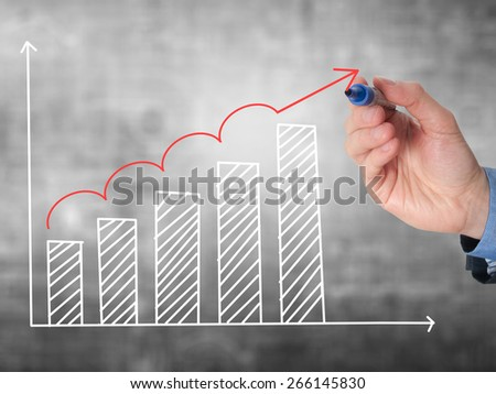 Business man hand drawing a graph. Growth concept. Isolated on grey background. Stock Image - stock photo