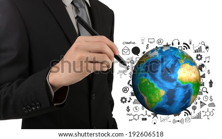 Business man hand drawing success graph with earth (Elements of this image furnished by NASA) - stock photo