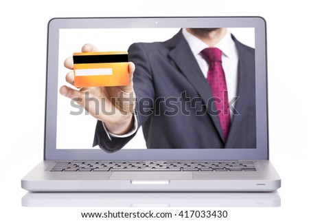 Business man hand holding a credit card through a laptop, isolated on white background