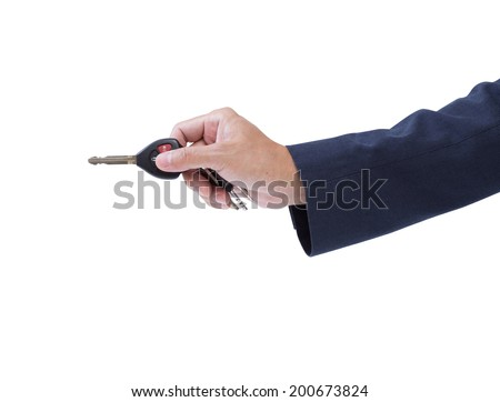 Business man hand holding car remote key isolated on white background, clipping path