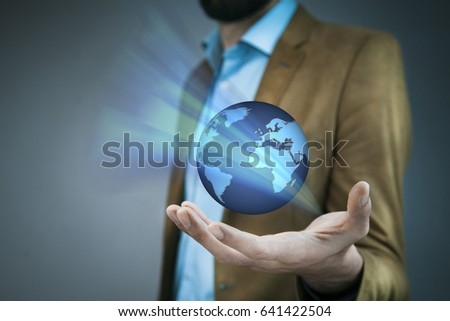 business man hand holding global planet in screen