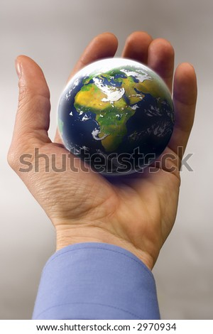 business man hand holding planet earth close up - stock photo