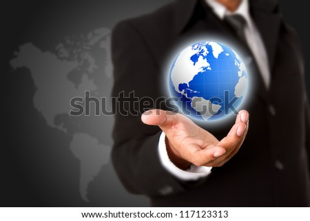 Business man hand holding  the business world