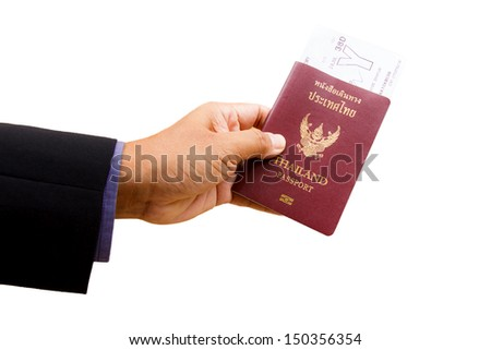 Business man hand holding the passport and ticket
