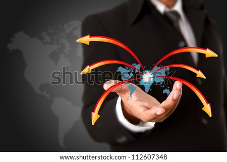 Business man hand holding world map - stock photo
