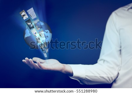 Business man hand  holding world.Technology concept