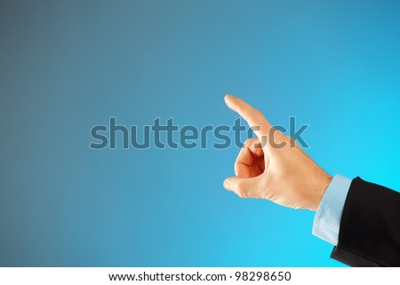 Business man hand pointing at something or selecting, you can easily add your text because of huge copy space - stock photo
