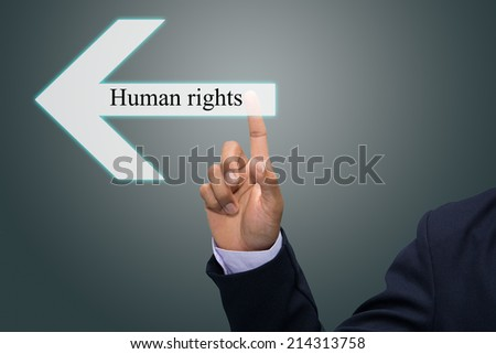 Business man hand pointing Human rights
