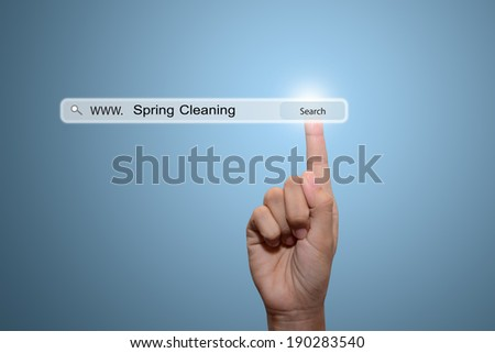 Business man hand pointing Spring Cleaning  - stock photo