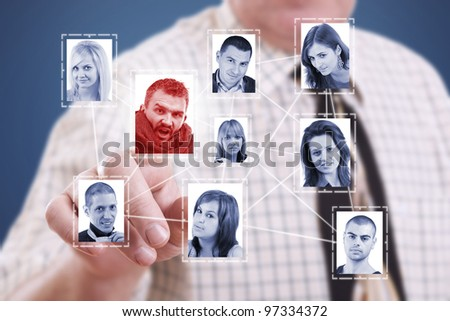 business man hand pressing Social network pictures - stock photo