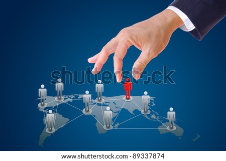 business man hand pushing people to social network - stock photo