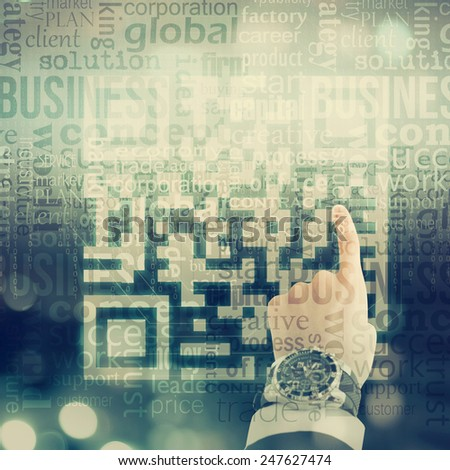 Business man hand QR code - stock photo