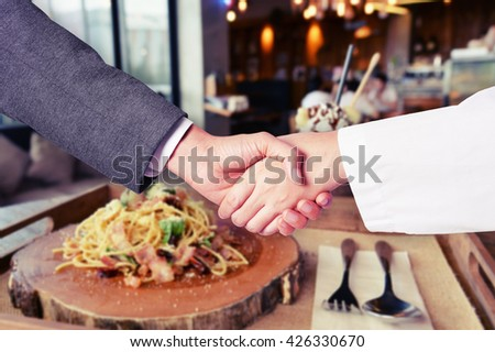 business man hand shake with chef hand - stock photo