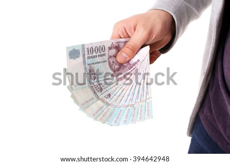 business man hand showing 10000 forint money banknotes isolated on white background