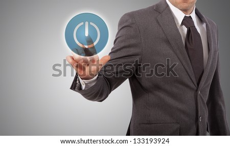 business man hand tapping on power button - stock photo