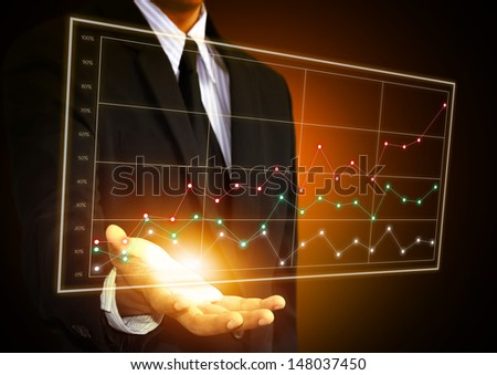 Business man hand touching a chart on screen - stock photo