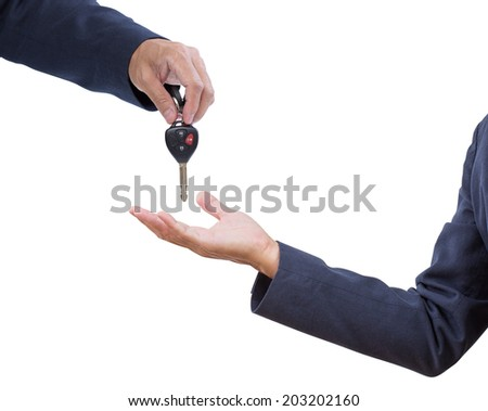 Business man hand with car remote key isolated on white background - stock photo