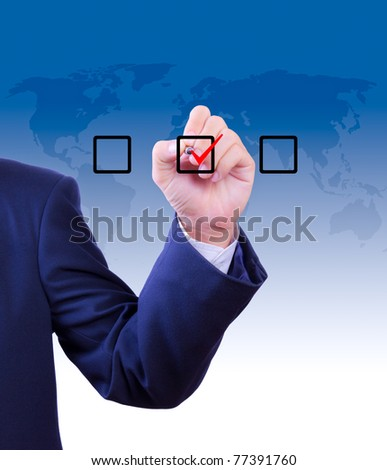 business man hand writing check mark on box - stock photo