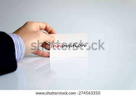 Business man hand writing innovation - stock photo
