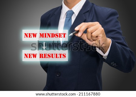 Business man hand writing New Mindset New Results  - stock photo