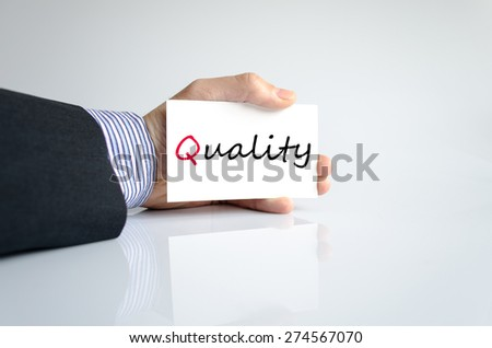 Business man hand writing quality - stock photo