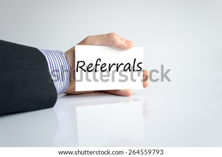 Business man hand writing Referrals