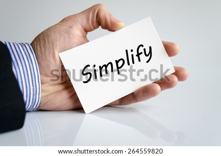 Business man hand writing Simplify - business concept - stock photo