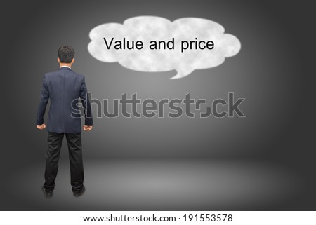 business man hand writing Value and price  - stock photo