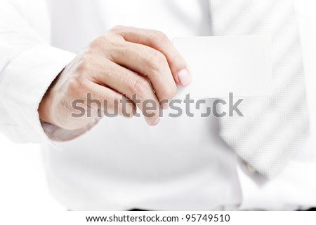 Business man handing a blank business card over white background