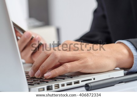 Business man hands typing on a PC or laptop keyboard
