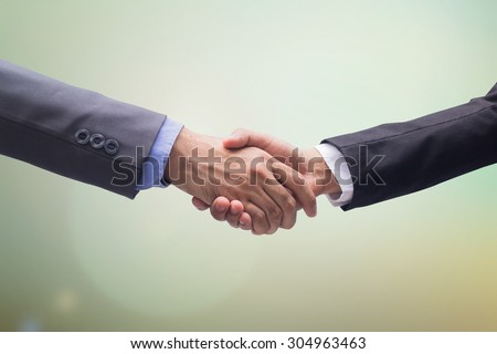 business man handshake over blurred backgrounds, business hands concept