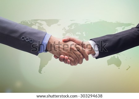 business man handshake over map on blurred green sky backgrounds, business hands concept - stock photo
