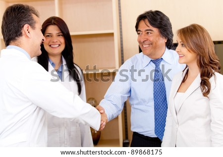 Business man handshaking with a doctor for making a successful sale - stock photo