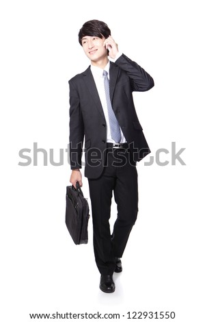 Business man happy Walking and speaking mobile phone in full length isolated over white background, asian model - stock photo