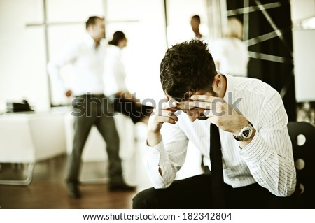 Business man having concerns about work - stock photo