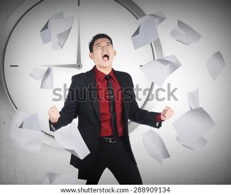 Business man having rage because work overtime - stock photo