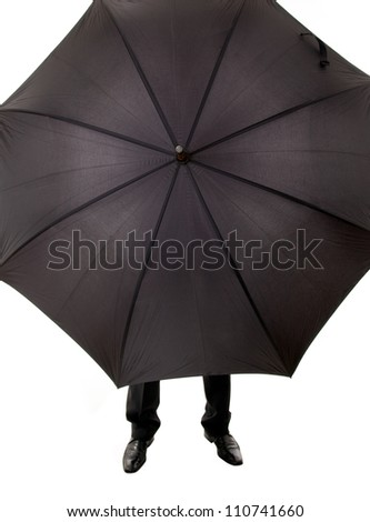 Business man hidden in umbrella against white background - stock photo