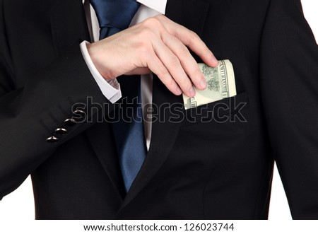 Business man hiding money in pocket isolated on white - stock photo